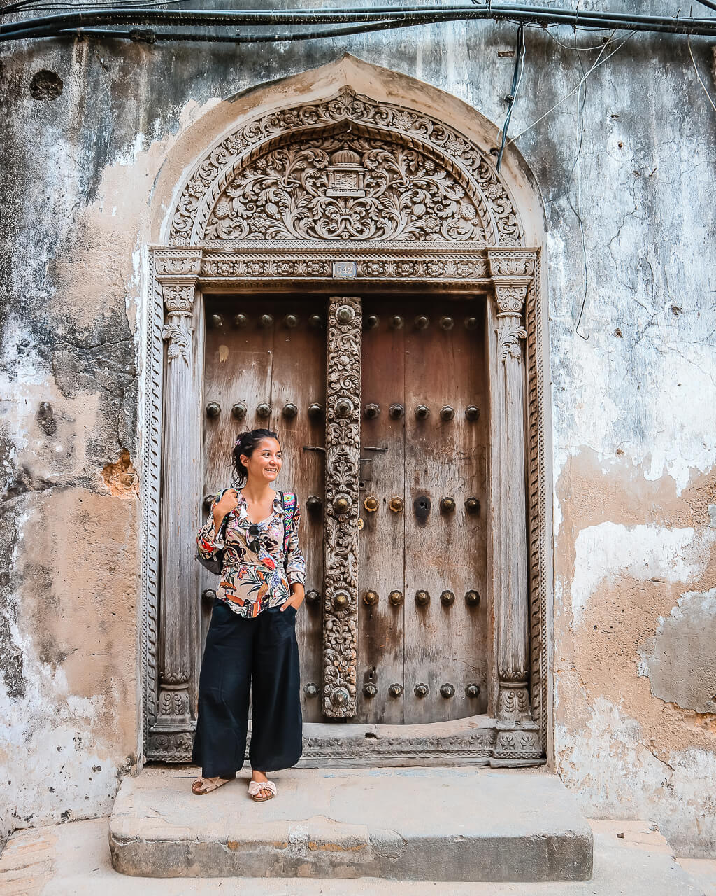 Woman standing in front of a big door Zanzibar Stone Town